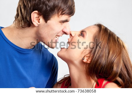Closeup profile portrait of angry lovers creaming on each other