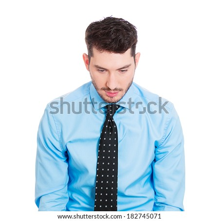 Closeup profile portrait of sad bothered stressed serious young man, looking down, depressed about something or someone, isolated white background. Negative human emotion facial expression feeling - stock photo