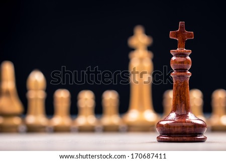 Closeup queen chess and row of competitor for business concept