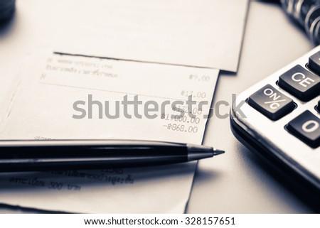 Closeup receipt on the desk - stock photo