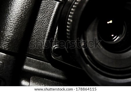 Closeup reflex Camera isolated on black. - stock photo