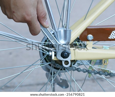 Closeup  repairing a bike with a wrench - stock photo