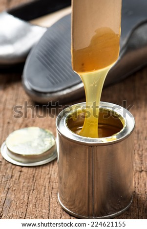 closeup rubber adhesive on wooden desk - stock photo