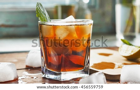 closeup rum in a glass with ice, view from above