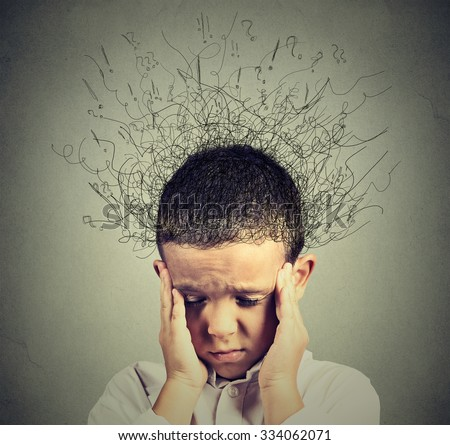 Closeup sad boy with worried stressed face expression looking down with brain melting into lines question marks. Obsessive compulsive, adhd, anxiety disorders concept  - stock photo