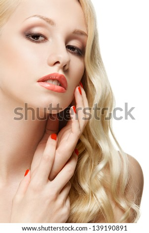 closeup sensual portrait of lovely girl touching her face against white background - stock photo