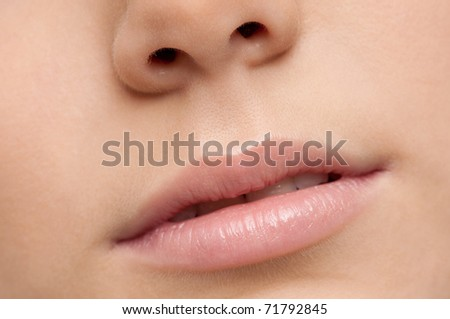 Closeup shoot of young beautiful girl with perfect skin: make-up mouth zone. Lips. - stock photo