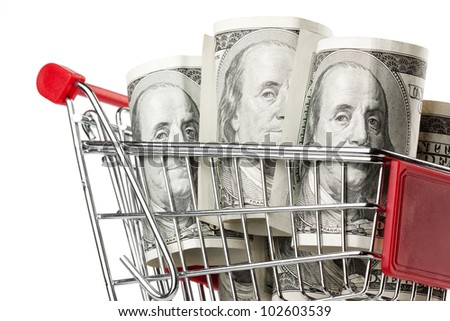 Closeup Shopping cart and dollars on a white background - stock photo