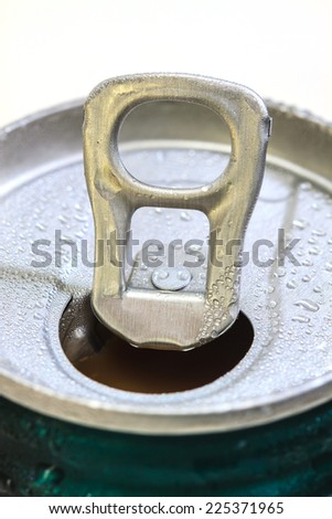Closeup shot from the pull ring on a beverage can, opened aluminum can with water drop - stock photo