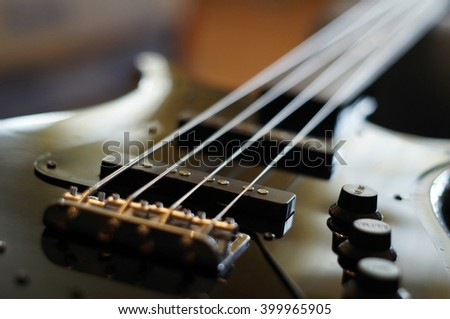 Closeup shot of a bass guitar pickup -  Fender Jazz Bass style pickup. - stock photo