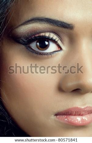 Closeup shot of a beautiful young asian woman's face with perfect makeup - stock photo