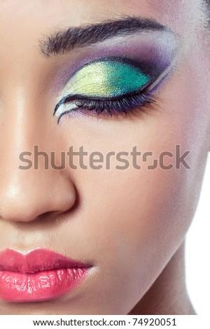 Closeup shot of a beautiful young woman's face with colorful makeup - stock photo