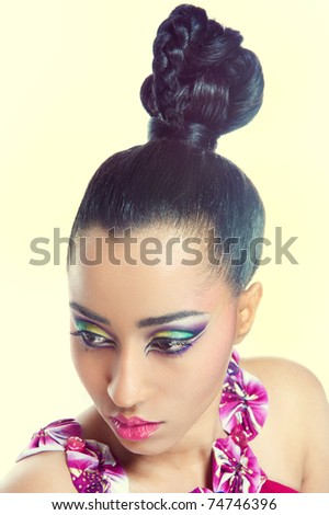 Closeup shot of a beautiful young woman with creative colorful makeup and fashionable hairstyle