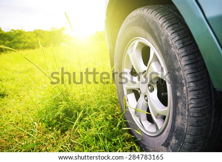 Closeup shot of a car against sun in the background. Selective focus - stock photo