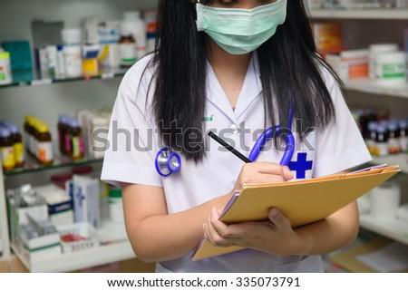 Closeup shot of a doctor writing a medical recipe - stock photo