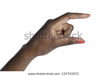 Closeup shot of a hand picking something over a white background - stock photo