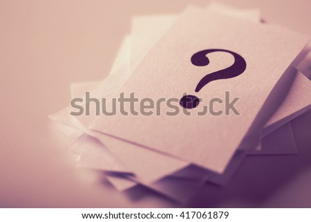 Closeup shot of a lot of paper with Question mark. - stock photo