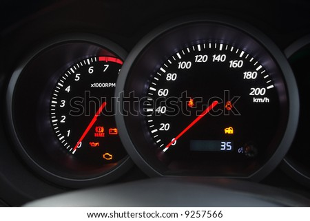 Closeup shot of a speedometer and tachometer of a modern car. - stock photo