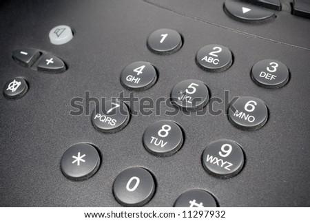 closeup shot of a telephone keypad - stock photo