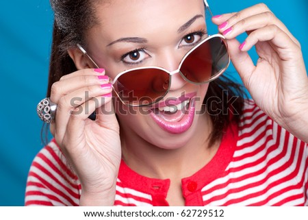 Closeup shot of a young happy surprised black model, looking over sunglasses