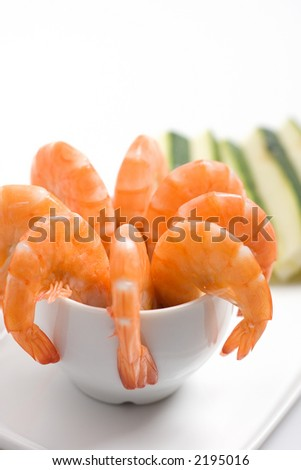 Closeup shot of an appetizer platter, with shrimps in a cup garnished with sliced zucchinis (shallow DOF) - stock photo