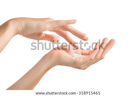 Closeup shot of beautiful female hands holding and applying moisturiser. Beauty woman's hand applying cream. Hands isolated on white background  - stock photo