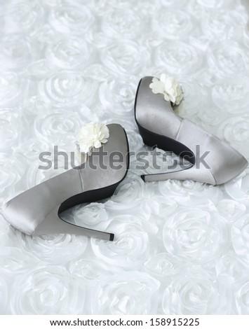 closeup shot of beautiful white shoes of the bride - stock photo