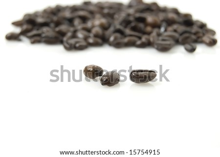 Closeup shot of coffee beans against white background