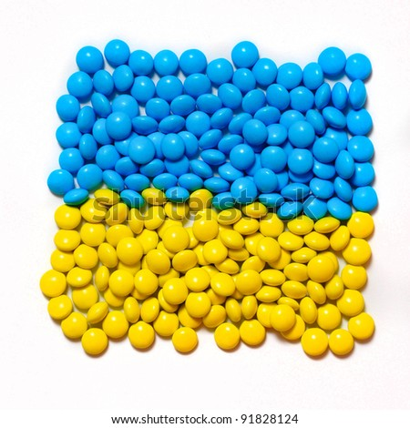 Closeup shot of colorful candies in the shape of Ukrainian flag
