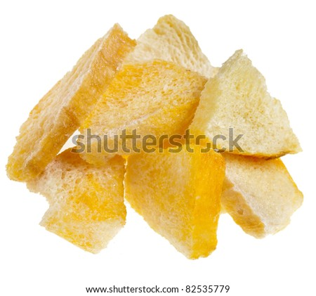 closeup shot of dried mango fruit slices chips, isolated on a white background