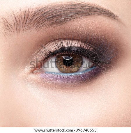 Closeup shot of female eye  with day makeup in 2016 year colors - aqua Limpet Shell color eye shadows and Snorkel Blue colour liner