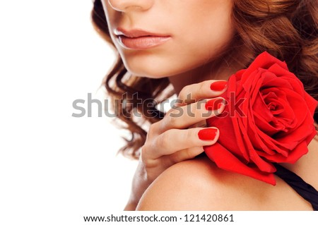 Closeup shot of female hand with beautiful red manicure holding red rose. Isolated on white background - stock photo