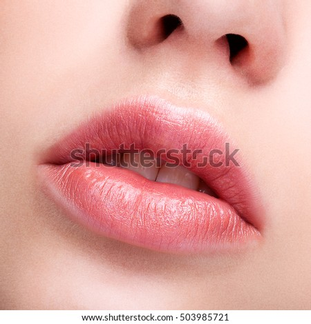 Closeup shot of female pink  plump lips makeup