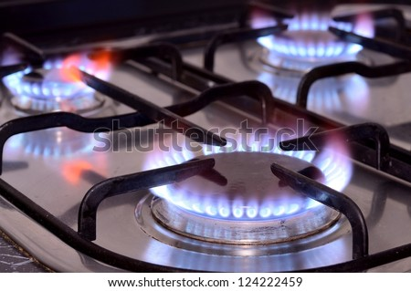 Closeup shot of fire from gas kitchen stove. - stock photo