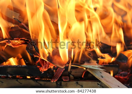 Closeup shot of fire, under my grill, for some background. - stock photo