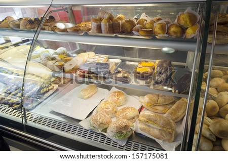Closeup shot of freshly made breads and sandwiches in Portuguese market. - stock photo