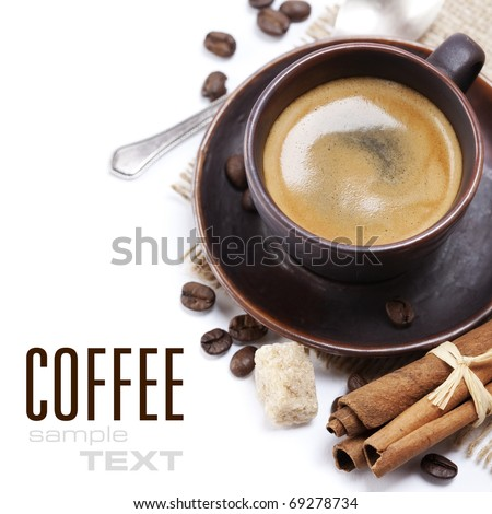 Closeup shot of freshly prepared cup of italian espresso with cinnamon, coffe beans, brown sugar and chocolate over white (with sample text) - stock photo