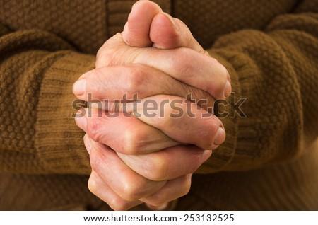 closeup shot of grandmother's hands praying together - stock photo