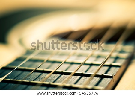 closeup shot of guitar and strings with shallow depth of field - stock photo