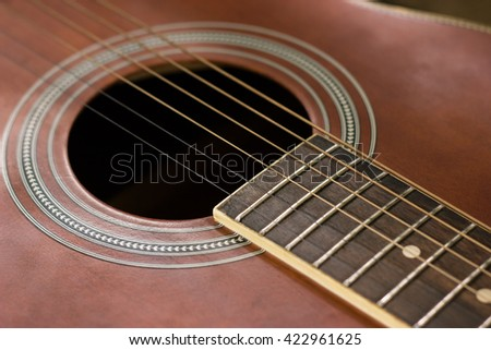 Closeup shot of Guitar's Sound hole and Rosette, selective focus on strings