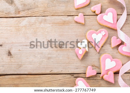 Closeup shot of heart shaped cookies. On old wooden table. - stock photo