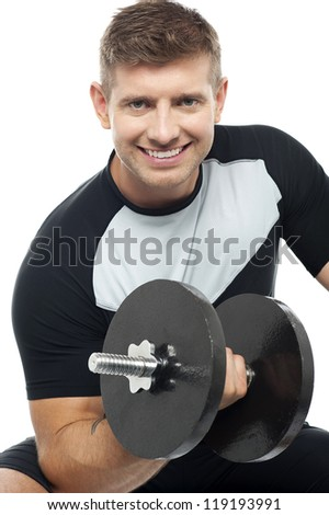 Closeup shot of masculine man doing biceps with dumbbell