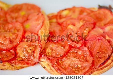 closeup shot of mini pizza with fresh tomatoes