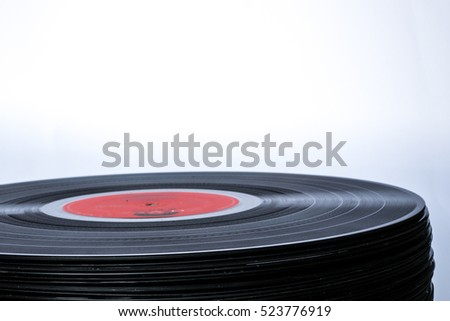 closeup shot of Old Stacked Vinyl Records, isolated on white background