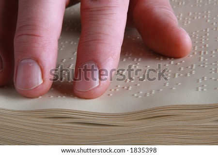 closeup shot of person reading Braille - stock photo