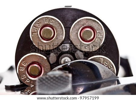 closeup shot of .38 revolver handgun's bullets in the storage cylinder - stock photo