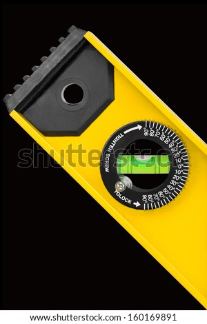 Closeup shot of spirit level for construction work isolated on black background - stock photo