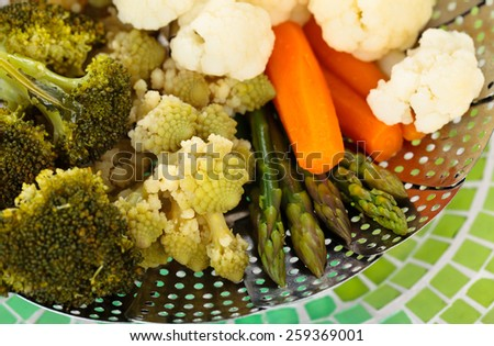 Closeup shot of steamed vegetables on steamer.  - stock photo