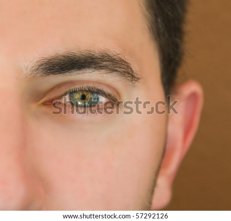 Closeup shot of the man'eye. - stock photo