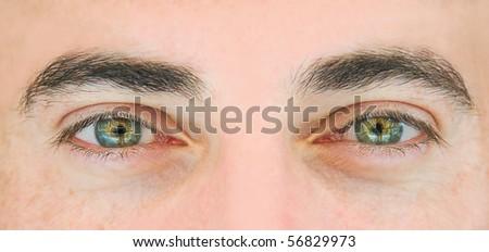 Closeup shot of the man's eyes. - stock photo